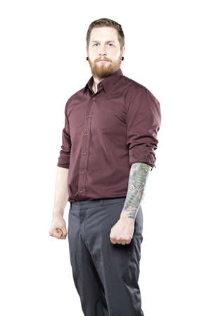 cool guy: Young man in suit with tattooes against white background looking tough Stock Photo