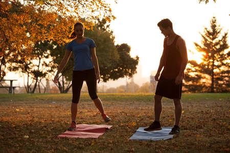 Woman yoga trainer demonstrating to student different positions photo