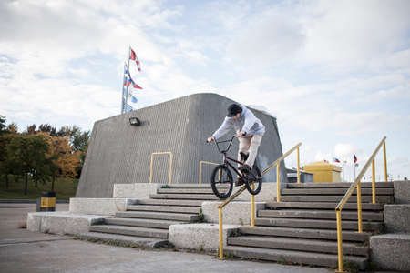 handrail: Bmx rider grinding on handrail in urban area, Montreal, Quebec, Canada