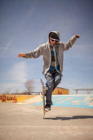 enthusiast: Young skateboard enthusiast in skatepark doing old school tricks