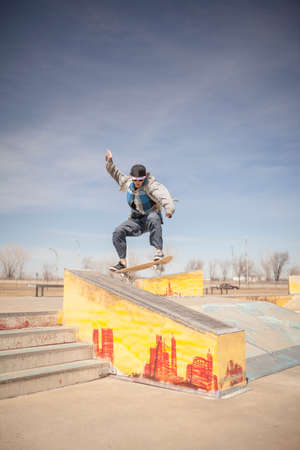 during the day: Young skateboard enthusiast in skatepark during day time Stock Photo