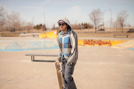 enthusiast: Young skateboard enthusiast in skatepark during day time Stock Photo