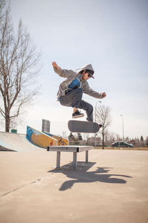 enthusiast: Young skateboard enthusiast in skatepark doing a kickflip