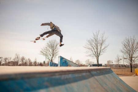 enthusiast: Young skateboard enthusiast in skatepark doing a benihana Stock Photo