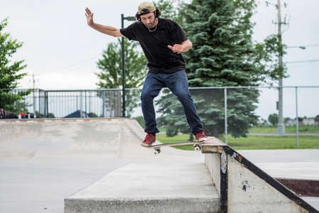 enthusiast: Older skateboard enthusiast skating around in skate park by alone