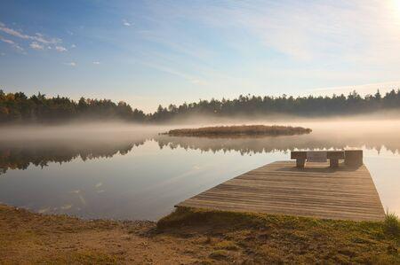 Misty Sunrise on Lake Stock Photo