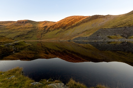 Reflections in Llyn Cwmorthin as the sunsets