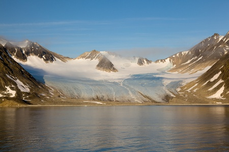 The wonderful golden glow of the midnight sun north of the Artic Circle on Spitsbergen
