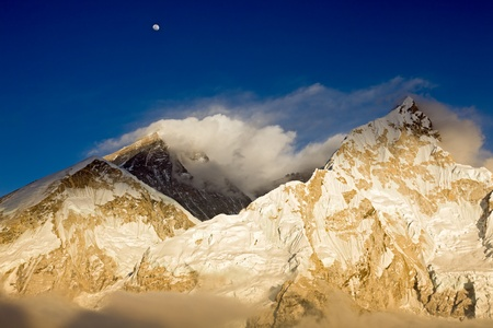 Mt Everest and Nuptse at sunset from Kala Patthar, with the moon rising above Everest Stock Photo