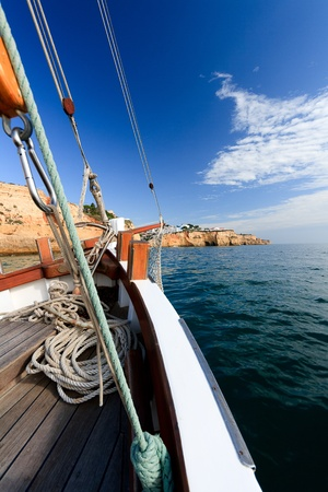 Sailing along the Portugese coast on a traditional boat Stock Photo