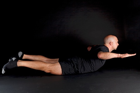Pilates Position - Swan Dive Stock Photo