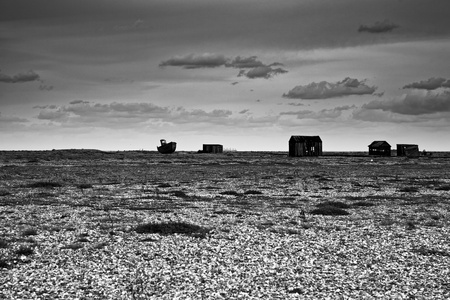 The desolate beach at Dungeness Stock Photo