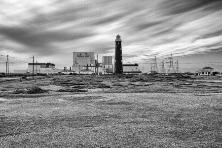 Dungeness Power Station and lighthouse as the cloud moves in