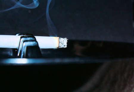 habbit: cigarette in ash tray