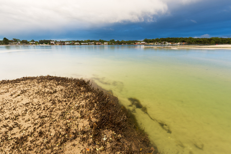 A storm passes over a tranquil river and mangrove system in eastern Australia. 版權商用圖片