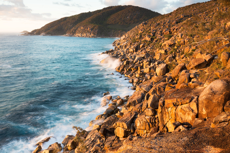 A rugged expanse of untouched coastline at sunrise in eastern Australia.