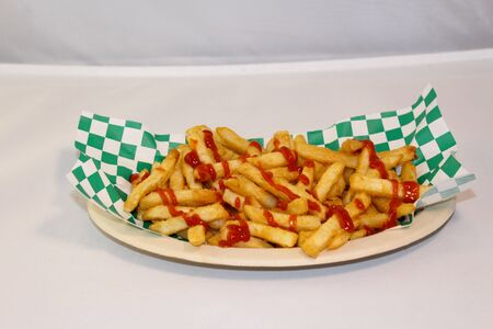 French Fries on checkered napkin Reklamní fotografie