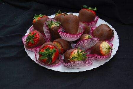 Chocolate covered strawberries on a plate