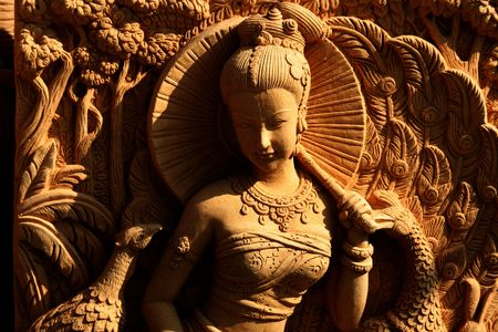 Thai lady carved in stone, Pattaya, Thailand. photo