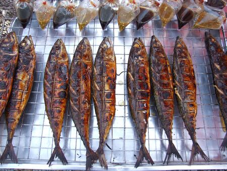 Cooked grilled fish for sale, Bangkok, Thailand. photo