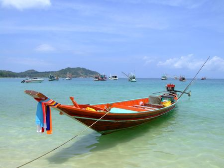Boat on the ocean in Koh Phangan, Thailand. photo