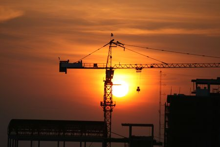 job site: Crane at sunset, Thailand.