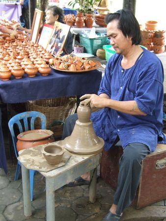 NAKOM PATHOM -  THAILAND, October 8: Potter at the wax museum in October 8, 2005 in Nakom Pathom, Thailand.