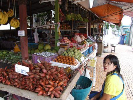 BANGKOK, THAILAND - OCTOBER 30: Thai women sits beside her stall selling tropical fruit October 30, 2005 in Bangkok.