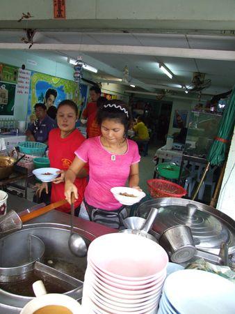 BANGKOK, THAILAND - OCTOBER 30: Thai women cook Thai noodles for customers in a restaurant October 30 , 2005 in Bangkok.