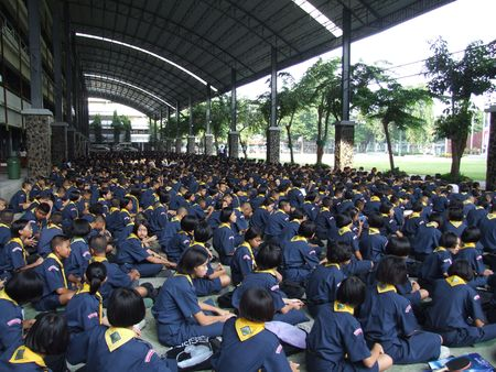 BANGKOK, THAILAND - DECEMBER 20 : Students sit outside for morning assembly at Seekan school December 20, 2005 in Bangkok.  Stock Photo - 7492243