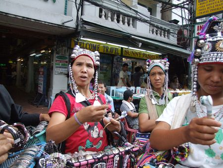 BANGKOK, THAILAND - AUGUST 3: Thai hill tribe women sell jewelery to tourists at Khaosarn road August 3, 2007 in Bangkok.