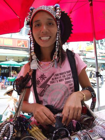 BANGKOK, THAILAND - AUGUST 3: Thai hill tribe woman sells jewelery to tourists at Khaosarn road August 3, 2007 in Bangkok.