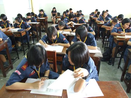 SEEKAN SCHOOL, BANGKOK, THAILAND- MAY 11: Students sit in the classroom learning English. Seekan School, Don Muang in May 11 2005 in Bangkok.