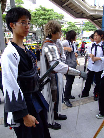 BANGKOK, THAILAND - AUGUST 4: Young models dressed as a samurai warrior and knight pose for photographers. MBK shopping center, August 4 2007 central Siam, Bangkok.