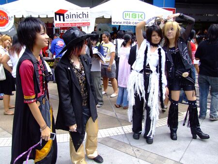 BANGKOK, THAILAND - AUGUST 4: Young models dressed in Japanese clothing pose for photographers. MBK shopping center on August 4 2007 in central Siam, Bangkok.