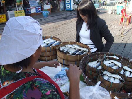 BANGKOK, THAILAND - MAY 17 : Woman sells fish at fish market May 17, 2005 in Bangkok.  Stock Photo - 7492270