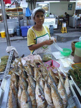 BANGKOK, THAILAND - MAY 18: Thai woman sells fish at fish market May 18, 2005 in Bangkok.