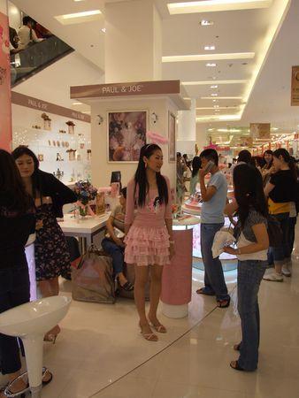 BANGKOK, THAILAND - JANUARY 8: Models advertise cosmetics at the Siam Paragon shopping center at the grand opening. January 8 2005, Siam center, Bangkok.  Stock Photo - 7492294