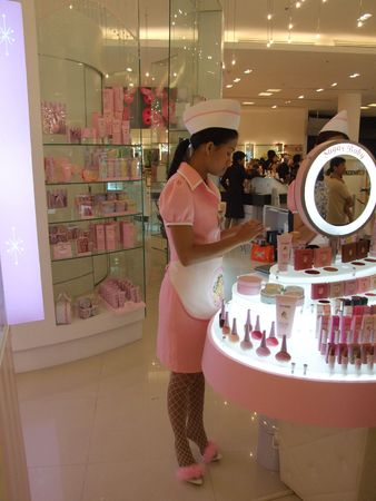 BANGKOK, THAILAND - JANUARY 8: Model girl in pink stands to advertise various cosmetics at the Siam Paragon shopping center at the grand opening. January 8 2005, Siam center, Bangkok.  Stock Photo - 7492332