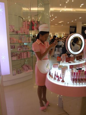 BANGKOK, THAILAND - JANUARY 8: Model girl in pink stands to advertise various cosmetics at the Siam Paragon shopping center at the grand opening. January 8 2005, Siam center, Bangkok.  Stock Photo - 7514657