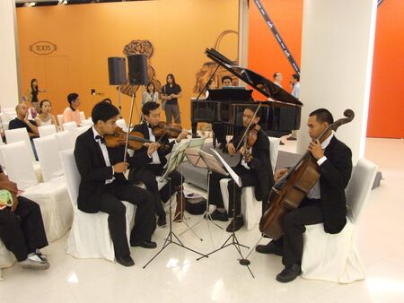 a rehearsal: BANGKOK, THAILAND - JANUARY 8: Thai musicians play classical music at the Siam Paragon shopping center at the grand opening. January 8 2005, Siam center, Bangkok.
