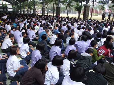 BANGKOK, THAILAND - DECEMBER 20 : Students sit outside for morning assembly at Seekan school December 20, 2005 in Bangkok.