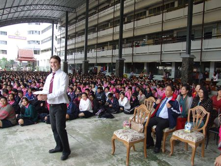 BANGKOK, THAILAND - DECEMBER 21 : English teacher gives speech while students sit outside for assembly at Seekan school December 21, 2005 in Bangkok.  Stock Photo - 7492371