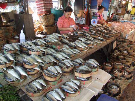 fish vendor: BANGKOK, THAILAND - JANUARY 20 : Women sell fish at fish market January 20, 2006 in Bangkok.
