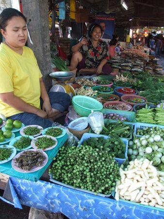 BANGKOK, THAILAND - JANUARY 20 : Women in a market sell vegetables in central Bangkok January 20, 2006 in Bangkok.  Stock Photo - 7492396