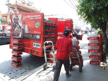BANGKOK, THAILAND - FEBRUARY 16 : Thai men deliver coke to a restaurant February 16, 2006 in Bangkok.