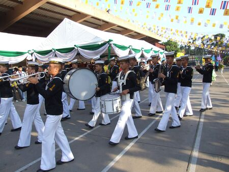BANGKOK, THAILAND - DECEMBER 22: Thai navy cadets stand playing music on sports day at Thewphaingarm school on December 22, 2006 in Bangkok.