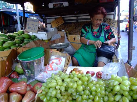 BANGKOK, THAILAND - APRIL 3: Thai woman sells fruit from inside a van on April 3, 2007 in Bangkok.  Editorial