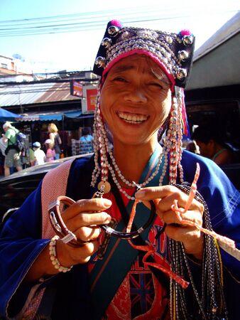 BANGKOK, THAILAND -SEPTEMBER 23: Thai hill tribe woman sells jewelery to tourists at Khaosarn road September 23, 2007 in Bangkok.