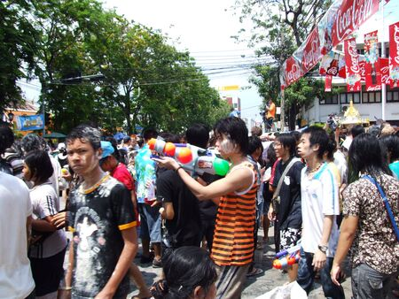 BANGKOK, THAILAND - APRIL 13: People throw water to celebrate the Songkran new year festival on April 13, 2007 in Bangkok, Thailand. The water is thrown because April is Thai summer and 40 degrees Celsius.  Stock Photo - 7514679